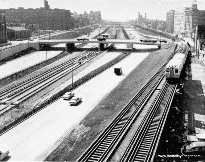 "By the time this picture was taken in May 1958, the four-track Metropolitan ""L"", shown here near Aberdeen Street, had been shaved back to two, since part of the ""L"" footprint was needed for the expressway. Behind the two-car train of 6000s there is a ramp leading down to the temporary Van Buren trackage of about 2 ½ miles heading west."