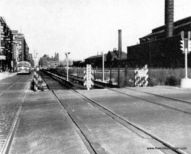 "The temporary ""L"" service in Van Buren Street, which operated from September 1953 to June 1958, shown here at Loomis prior to the demolition of the cavernous Throop street shops at right."
